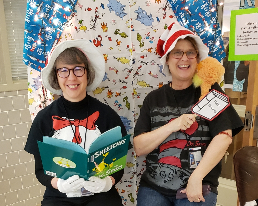 Photo of Librarians with Dr. Suess-themed props.